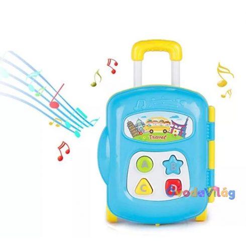 Zenélő babajáték - Bőrönd